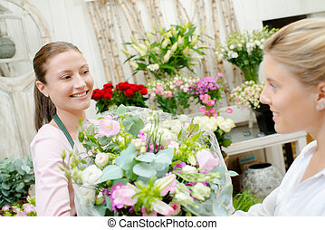 Customer picking up a bouquet of flowers