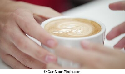 Customer receives an order from the hands of barista, coffee...