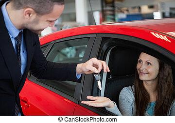 Customer receiving car keys