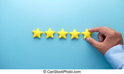 Customer review concept. Rating golden stars on blue ...