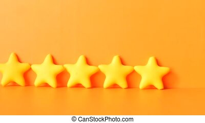 Customer review concept.Rating golden stars on orange ...