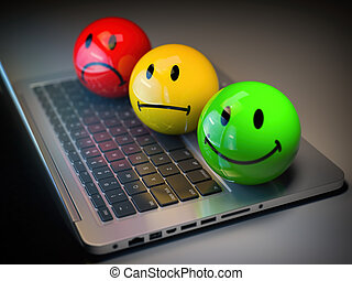 Customer satisfaction h feedback rating concept. Colored smile emoticons on laptop keyboard.