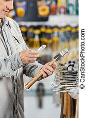 Customer Scanning Hammer Through Mobilephone