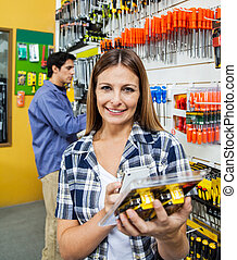 Customer Scanning Product Through Mobile Phone - Portrait of...