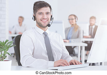 Customer service consultant at work - Smiling handsome ...