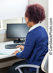 Customer Service Executive Analyzing Documents