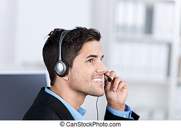 Customer Service Executive Conversing On Headset