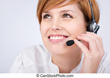 Customer Service Executive Speaking On Headset - closeup of...