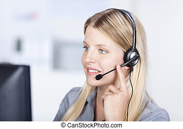 Customer Service Executive Using Headset While Conversing