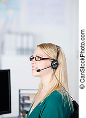 Customer Service Executive Using Headset While Looking Away