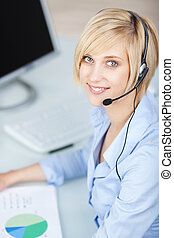 Customer Service Executive Wearing Headset At Desk