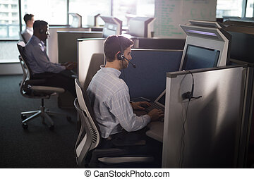 Customer service executives working at office - Attentive ...