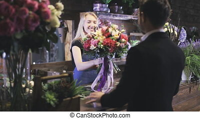 customer service in flower shop - Woman in a florist's shop,...