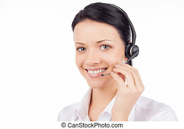 Customer service representative. Beautiful young woman in headset smiling and looking at camera while isolated on white