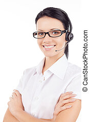 Customer service representative. Confident young woman in headset smiling and keeping her arms crossed while standing isolated on white