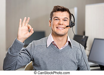 Customer Service Representative Showing Ok Sign - Portrait...