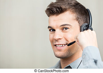 Customer Service Representative Speaking With Costumer