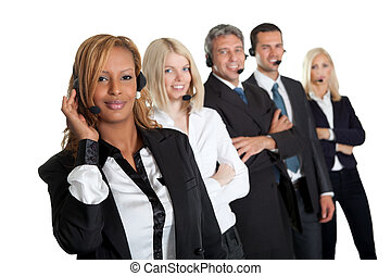 Happy customer service representatives standing in a row against white background