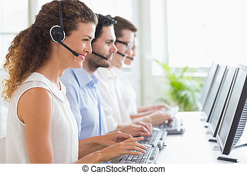 Customer service representatives working at desk