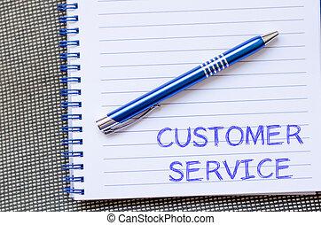 Customer service write on notebook