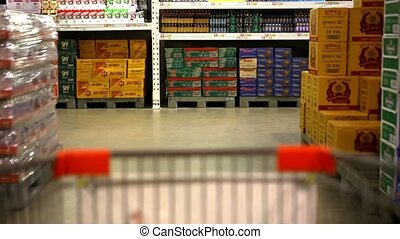 Customer shopping at supermarket with trolley. Video shift motion time lapse speed up
