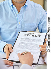 customer signing contract document at office