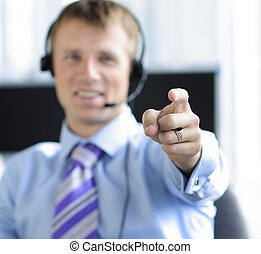 Customer support executive pointing towards you