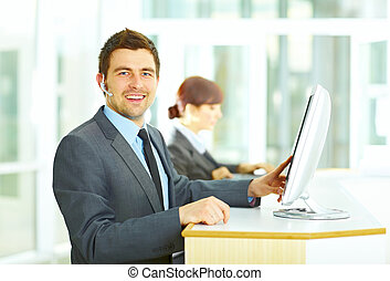 Customer support operator in office