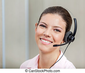 Customer Support Operator With Headset - Smiling female...