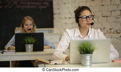 Customer support operator working in a call center