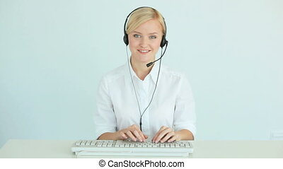 Customer support representative consulting clients online...