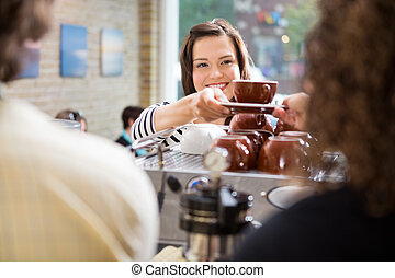 Customer Taking Coffee From Barista - Young female customer...