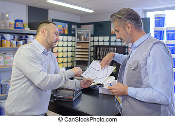 customer talking and choosing color in a household store
