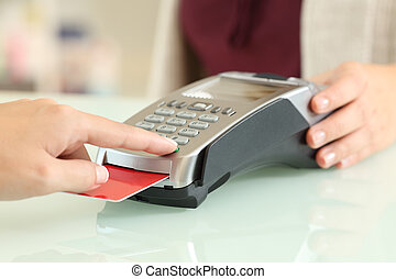 Customer typing pin in a credit card reader