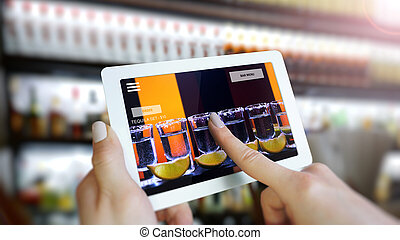 Customer use AR application to order drink at the bar, Hand touching interface