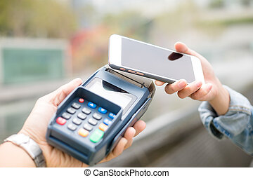Customer using mobile phone for pay by the bill