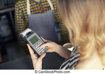 Customer using pin entry credit card reader
