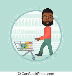 Customer walking in store with shopping trolley.