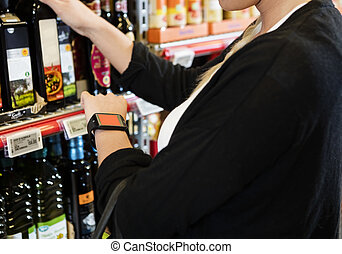 Customer Wearing Smart Watch In Grocery Store