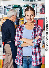 Customer With Arms Crossed In Hardware Store