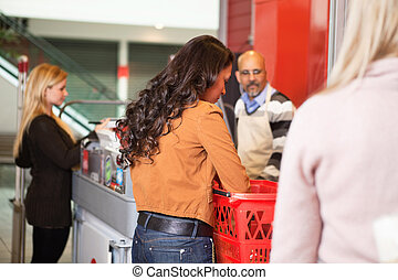 Customer with basket while shopping