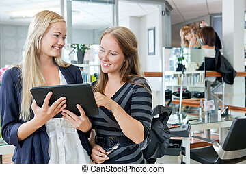 Customer With Hairdresser Holding Digital Tablet - Young...