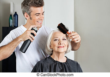 Customer With Hairstylist Setting Up Hair