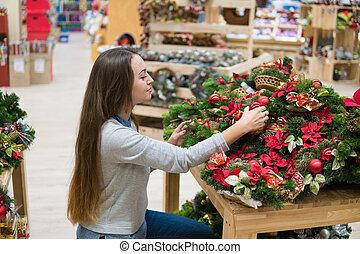 customer woman choosing Christmas decorations - Pretty...