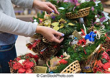 customer woman choosing Christmas decorations - Closeup view...