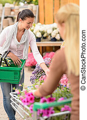 Customer woman shopping for flowers garden center