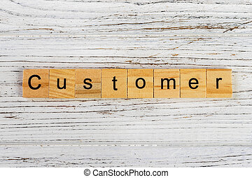 CUSTOMER word made with wooden blocks concept