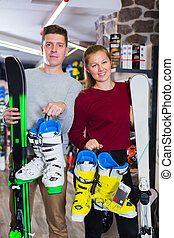 Customers are demonstrating ski and boots