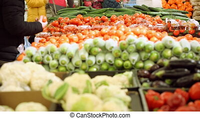 Customers at vegetable shop