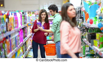 Customers choosing cleaning product